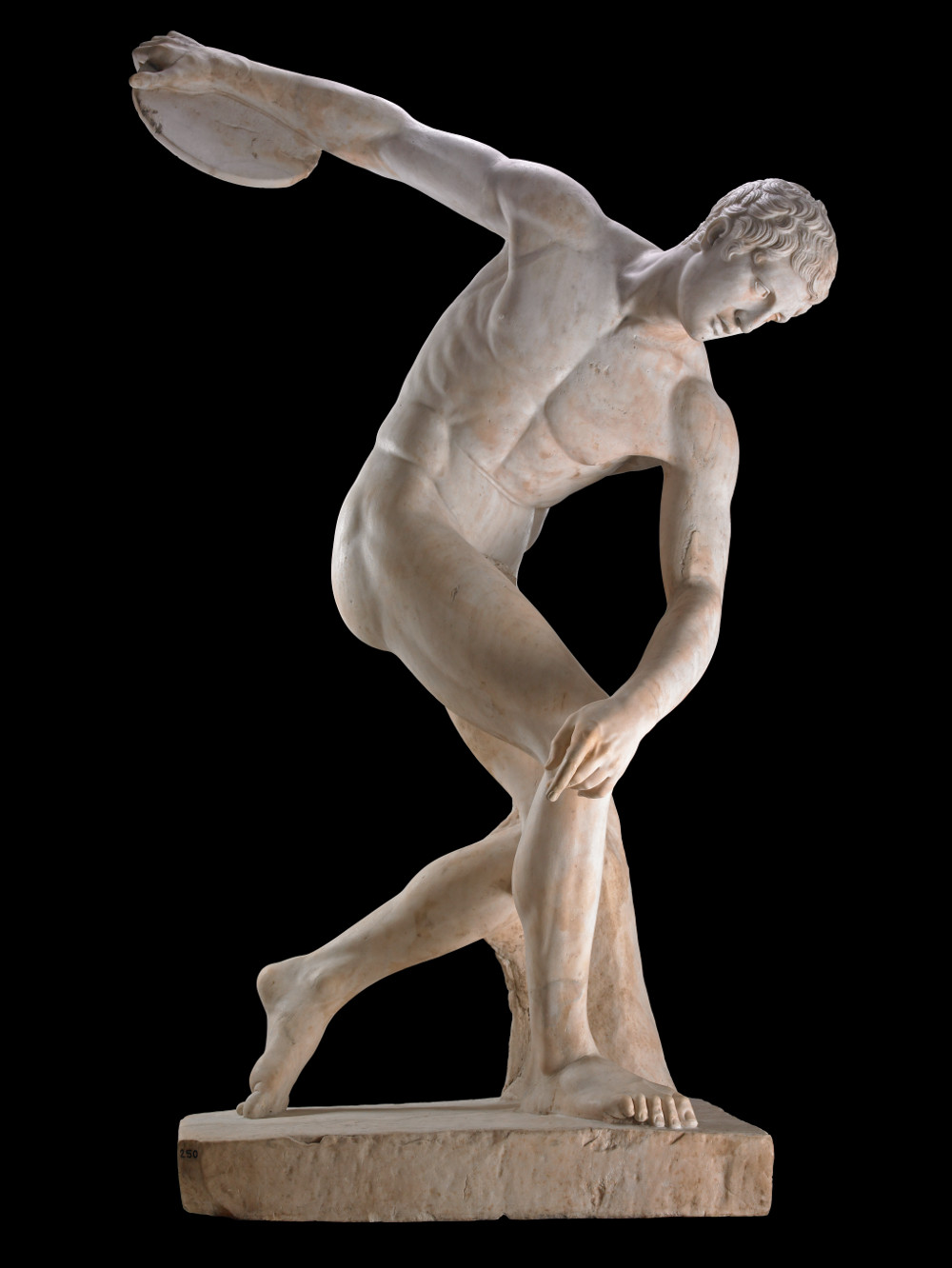The Townley Discobolus - Marble100–200 ADRoman copy after Greek statueBritish MuseumThis Roman copy of the ancient Greek sculpture of Discobolus, or discus-thrower, is one of the most famous sculptures from the ancient world and the British Museum. It shows an idealised athlete – naked, refined and eternally youthful – seemingly captured in the moment before releasing the discus. Discobolus embodies the idea of balancing opposing forces. In the rhythm and harmony of his proportions, the ancient Greeks saw an underlying order behind the chaos of the world.