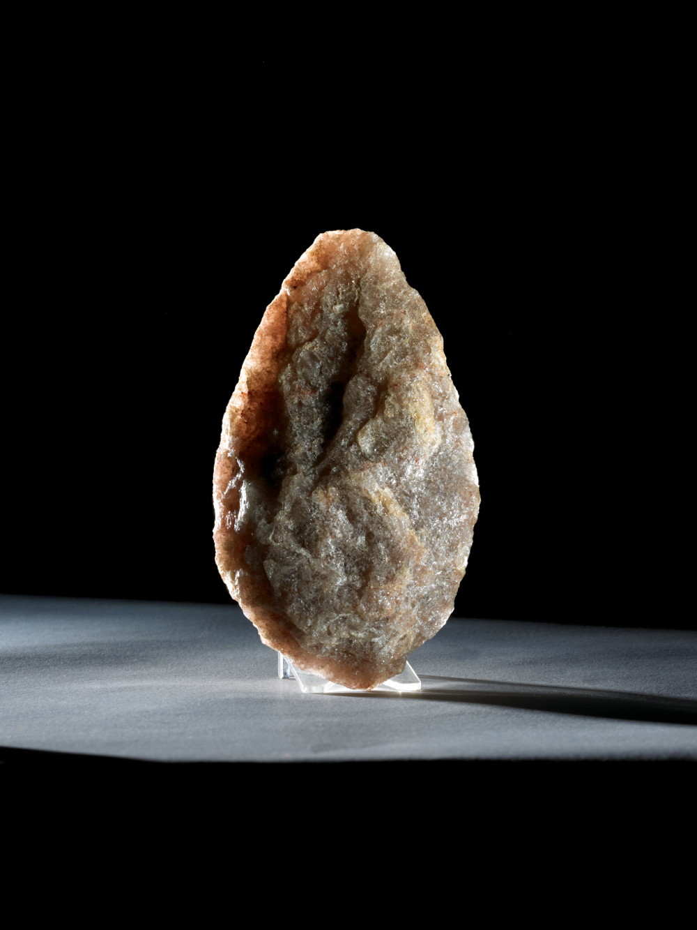Olduvai handaxe - Quartz800,000–400,000 years oldFound in Olduvai Gorge, TanzaniaBritish MuseumThis handaxe is a masterpiece of the toolmaker's art. Made of quartz, a difficult material from which to make tools, it was thinned and refined to create a symmetrical, teardrop shape which added little to its usefulness. This suggests that the skill invested in producing beautiful handaxes may have had other purposes – they may have been status symbols or used in rituals. By surpassing functional demands, handaxes may be said to represent the earliest indication of artistic endeavour.
