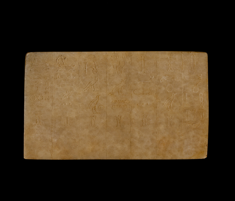 Hieroglyphic tablet for sacred oils  - Calcite2686–2134 BCEgyptBritish MuseumThis tablet is engraved with columns of hieroglyphs, which developed as a writing system over 5,000 years ago in Egypt. This document was made to serve a religious purpose and lists the sacred oils that were used in Egyptian burial rituals. The text combines both visual representations and phonetic symbols. Each engraved column contains the name of one of the seven sacred oils, and below each name is the hieroglyph of an oil jar.