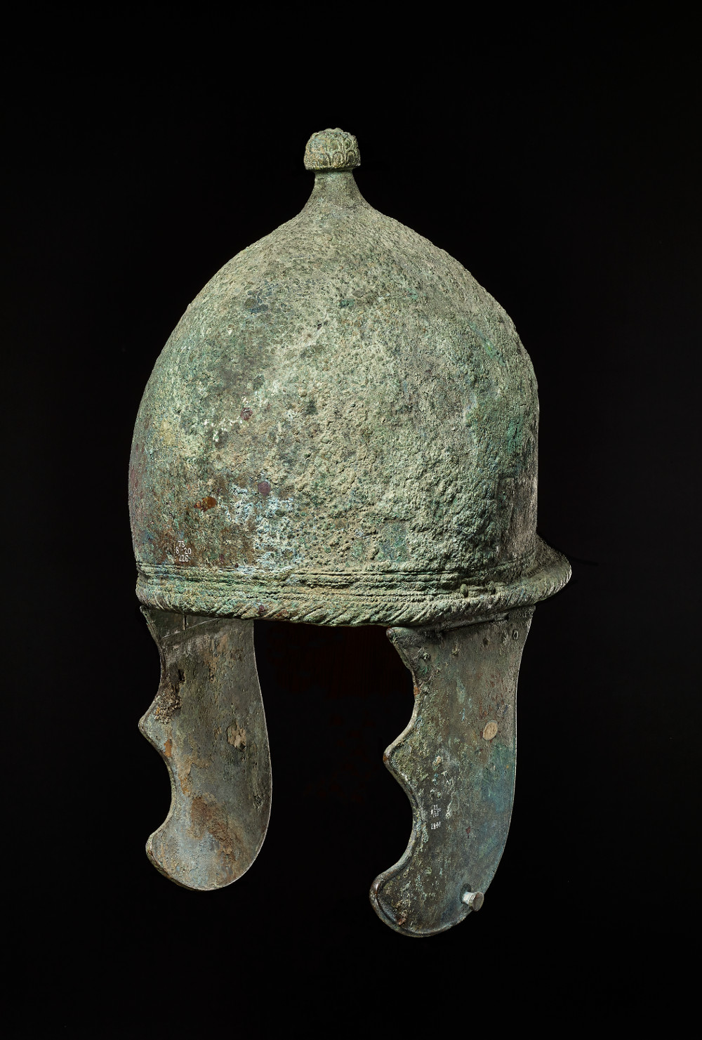 Roman Montefortino helmet  - Bronze299–200 BCPuglia, ItalyBritish MuseumThe Montefortino helmet was introduced to Italy by invading Celts. It is arguably the most successful type of helmet ever designed. The type is distinguished by its neckguard, topknot and cheek-pieces, though these attachments rarely survive. The Roman army deployed this style of helmet unchanged for centuries. It is a prime example of the Romans incorporating the most successful elements of opposing armies into their strategy.