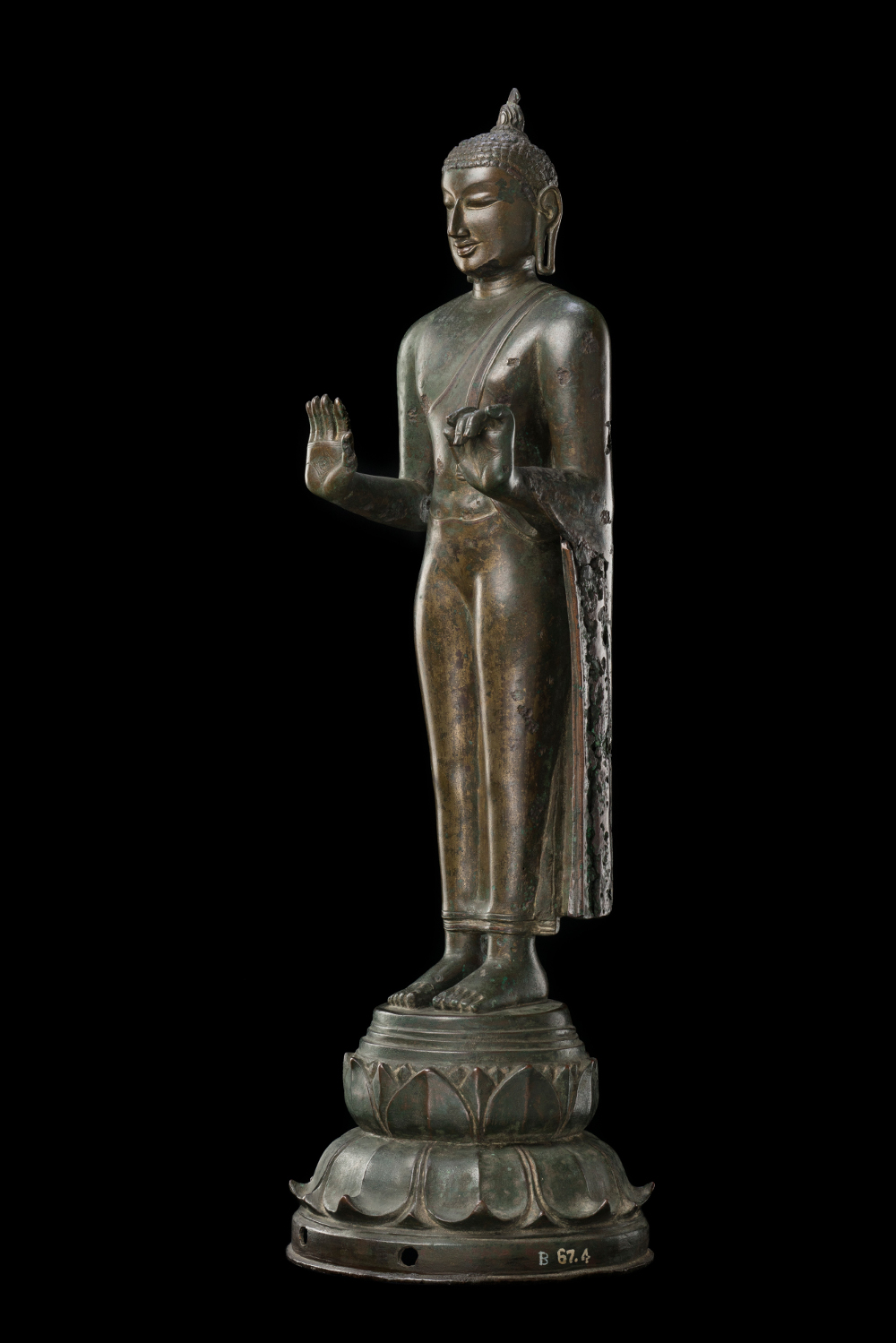 Chola Buddha - BronzeAD 900–1000 Nagapattinam, Tamil Nadu, IndiaGift from the Collection of Smt. Amravati Gupta CSMVS, MumbaiThis statue comes from the port town of Nagapattinam, a leading centre of artistic production of Buddhist imagery during the reign of the Chola dynasty (about AD 880–1279). The flame on top of his ushnisha (cranial protuberance) is symbolic of the wisdom that is believed to have emerged during his meditation. The iconography of the flaming ushnisha directly influenced the images of the Buddha in Sri Lanka, from where it spread to East and Southeast Asia.