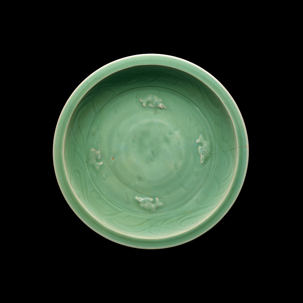 Celadon bowl  - PorcelainAD 1280–1368Made in Longquan, China and found in Khartoum, SudanBritish MuseumCeladon is the European name given to Chinese jade-green glazed pottery. They started to be made in the AD 900s and were popular in both China and other parts of Asia, the Middle East and East Africa. This porcelain bowl found in Sudan was made in one of the most Chinese famous kilns, Longquan in Eastern China. Celadon wares were originally favoured by the Chinese imperial court, probably because of the resemblance with jade, the most valued material in China.