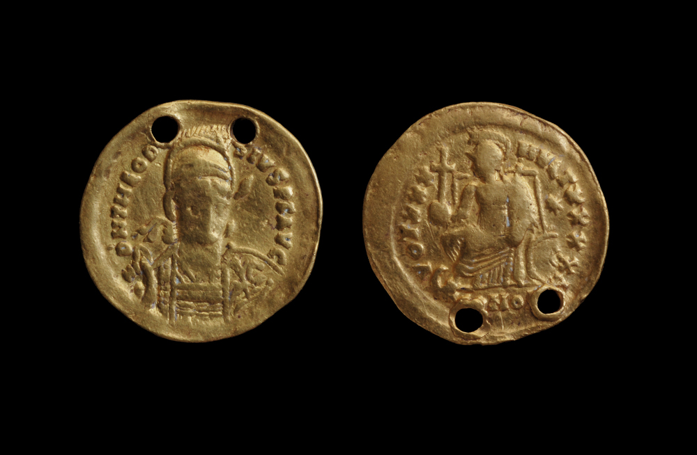 Coin with the portrait of the Emperor Theodosius - GoldAbout AD 385–395Ajanta, Maharashtra, IndiaArchaeological Survey of India, Aurangabad Circle This Roman coin comes from the reign of Emperor Theodosius (reigned AD 379–395) and was found at Ajanta, the site of the famous painted caves in Maharashtra. The two pierced holes indicate that this coin would have been worn as a pendant. Older gold coins were preserved for their value, and the date of the reign of Theodosius is no guarantee of the date at which it would have come to India.