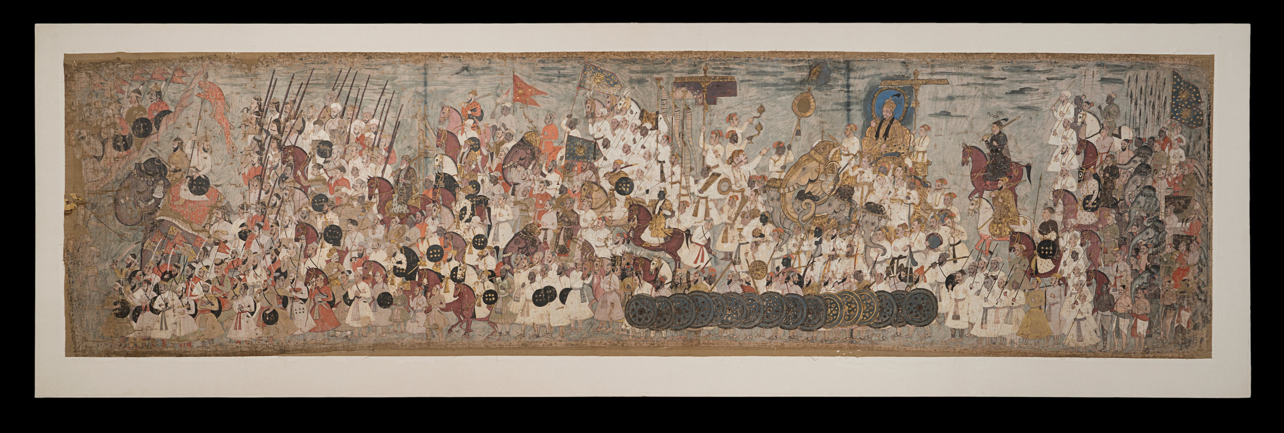 Procession of Abdullah Qutb Shah - Painting on clothAbout AD 1650Golconda, IndiaSir Akbar Hydari CollectionCSMVS, MumbaiThis painting depicts the military procession of the Golconda court of Abdullah Qutb Shah (reigned 1626–72) in the Deccan in south India. This is a public display of pomp and pageantry, with bearers of flags, incense-burners, and soldiers – some holding swords, some with lances and others with guns. Abdullah Qutb Shah famously surrendered his empire to the Mughals in 1636, rendering all this military pageantry slightly ironic.