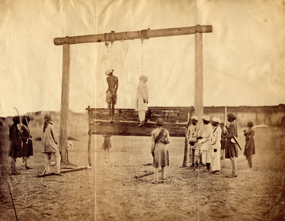 Execution of Mutineers' from the Album of Canon Richard Warner of Lincoln - Photograph by Felice BeatoAlbumen Print, 1858Alkazi Foundation for the Arts, New DelhiAn Italian-British photographer, Felice Beato (1832–1909) arrived in India in February 1858 to record the aftermath of the Revolt of 1857. He worked at Delhi, Kanpur and Lucknow under the guidance of military officers. Beato restaged the conflicts in order to photograph them, constructing both the extent of Indian outrage and the indiscriminate massacres exacted by the British as retribution. The photographs were used to justify the wresting of control from the East India Company to the crown in 1858, making India a British colony.