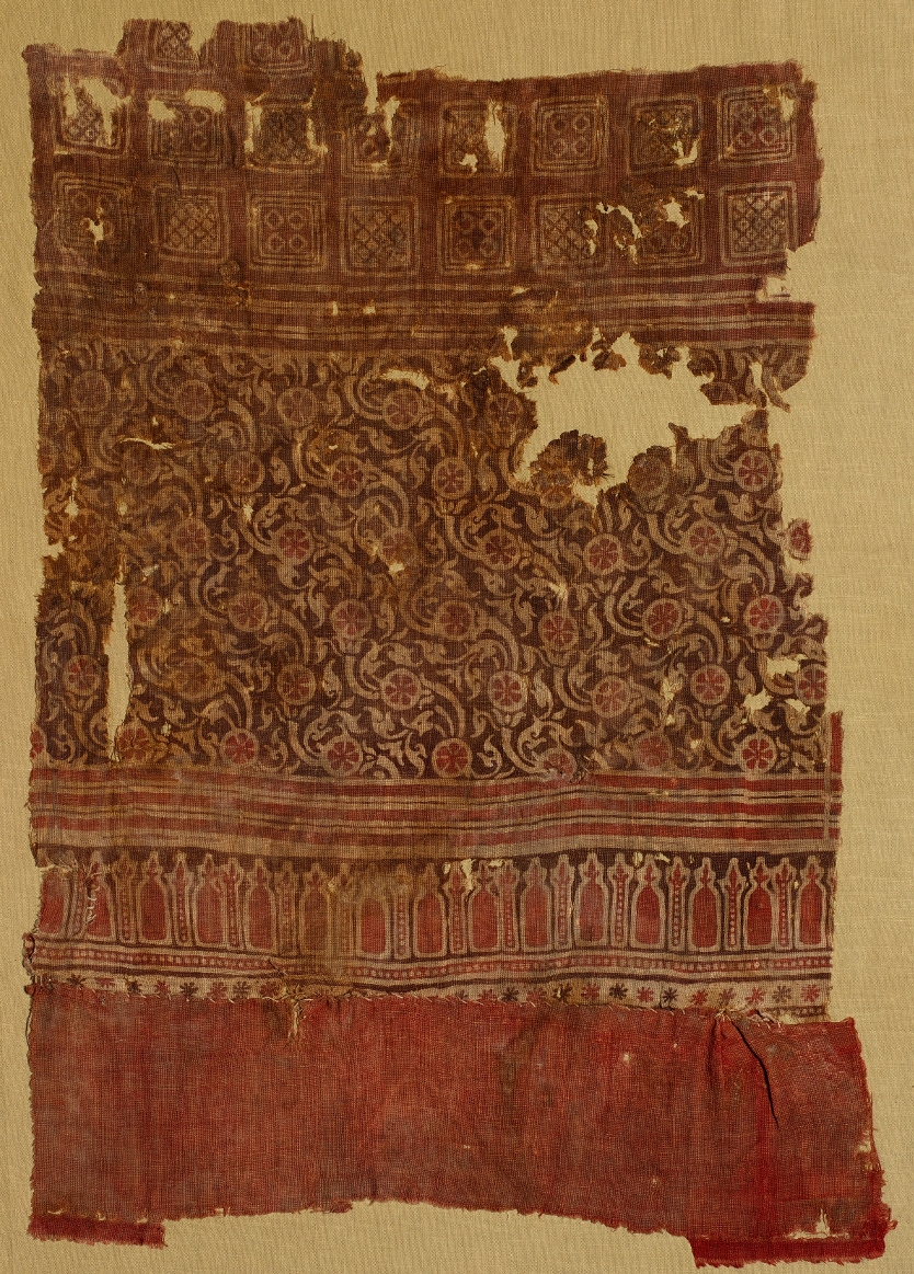 Cloth - CottonAD 1200–1400Made in India, found in Qasr Ibrim, EgyptBritish MuseumTextiles were at the heart of the Indian Ocean economy and Indian craftsmen were renowned for their skill in textile manufacture, producing both every-day and high-end goods which were in demand in the Mediterranean and Southeast Asia.This cloth, printed in undyed woven cotton, was made in India. It was discovered in a medieval grave in Egypt, wrapped around the body of a foetus. Preserved by the dry climate, this piece is a remarkable survivor.
