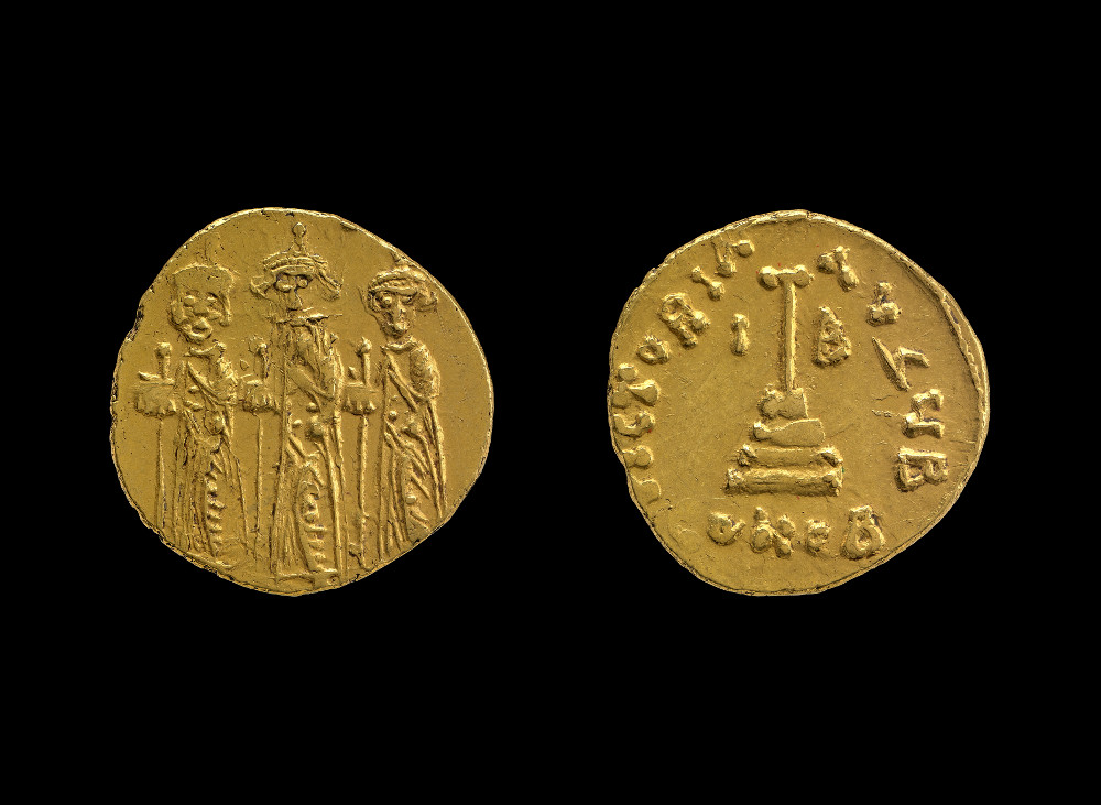 Arab-Byzantine dinar showing a standing emperor and sons - GoldAD 625–675Probably SyriaBritish MuseumThe earliest Islamic coins were copies of the coins of the Byzantine Empire. Byzantine coins showed the emperor and his sons on one side, and the Christian cross on the other. The Arab gold dinars struck during the time of the Umayyad caliph 'Abd al-Malik still showed the same emperor, but the reverse was altered. The cross was transformed into a post and the shahada, an Arabic inscription declaring the belief that there is one god and Muhammad is his prophet, was added.