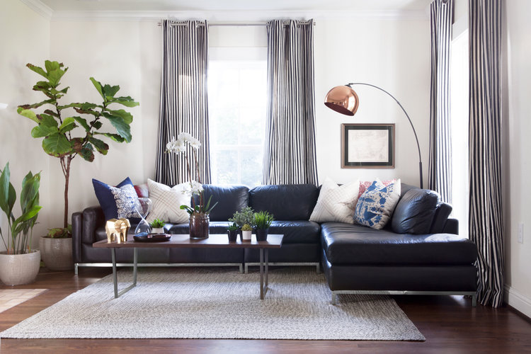 modern living room with leather type sofa