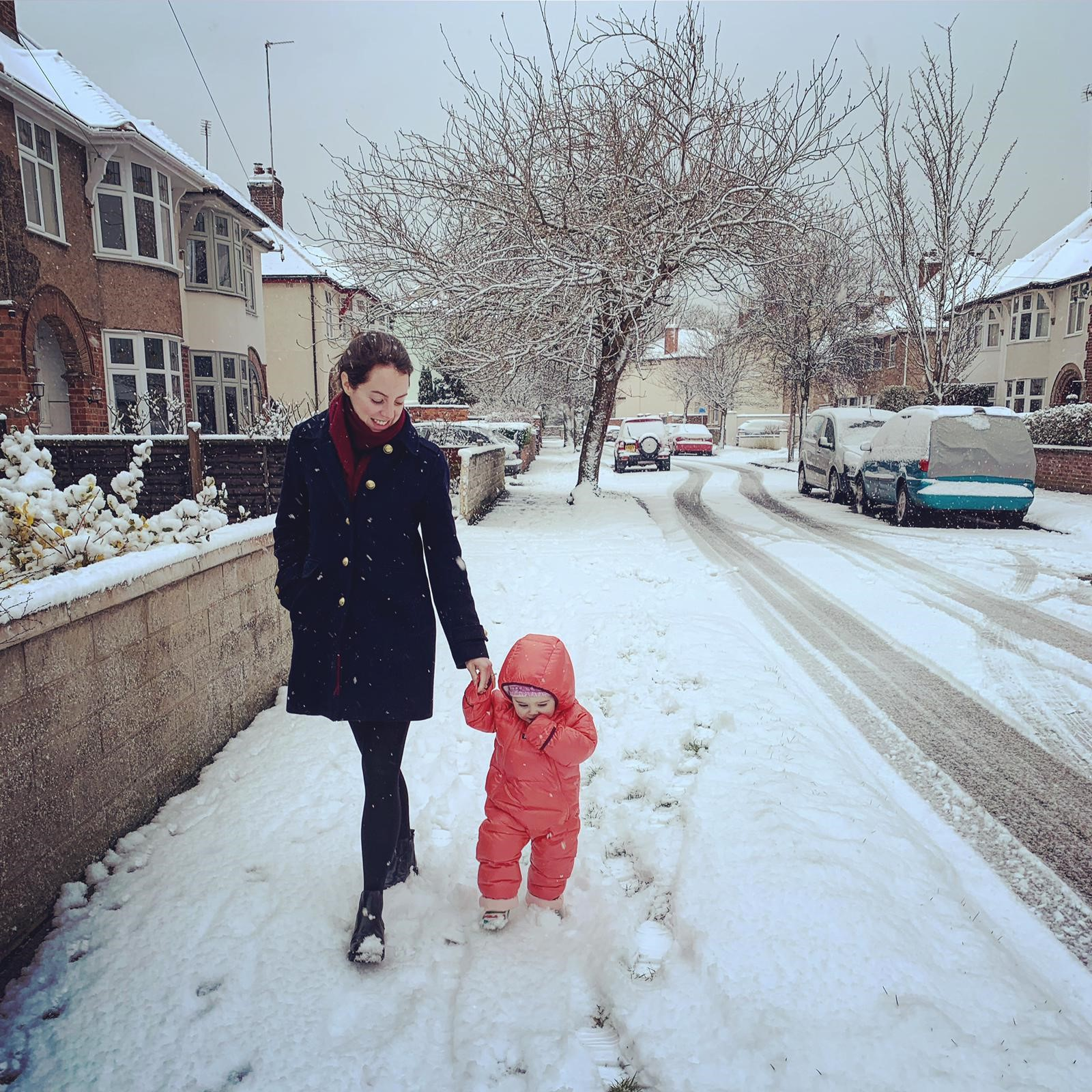 "Patagonia all-in-ones ""Wren loves it, like wearing a massive duvet. And the feathers make it warm and light - perfect"" - Wren (1) and Claire in snowy Cheltenham - where snow is a novelty!"