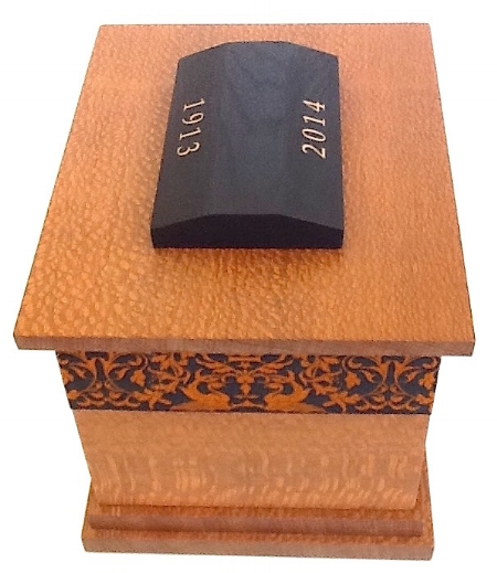 Quercus – 2015 – Funeral Urn with Gold Leaf inscribed birth & year of passing. 20cm W x 16cm L x 28cm H – with Ebonized Lacewood finial & Silk lining. Lacewood / Gold Leaf / Silk embroidered Ribbon Banding / Beeswax. PRIVATE COMMISSION