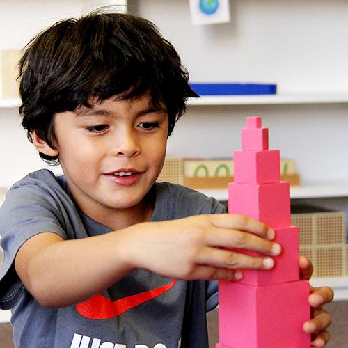 boy-playing-red-blocks.jpg