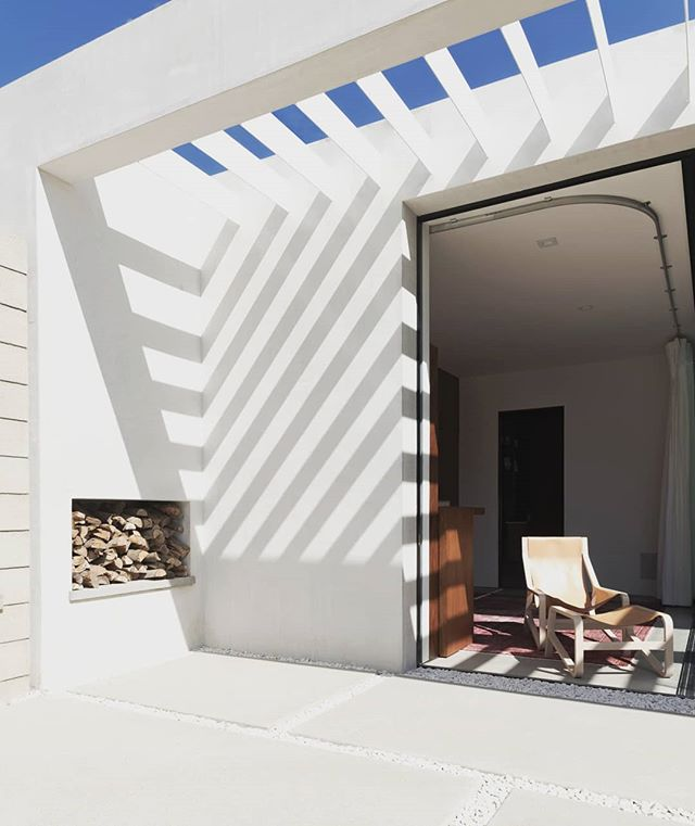 "Throwback to our first house in Venice.  This is the ""breezeway"" and fireplace beside the guest bungalow out back.  Now we have a second completed house for sale (on Broadway) and a third home is under construction (won't be for sale though). Chair is from @bludot #venicehouse #tbt #walkerworkshop #designbuild #architecturelovers"