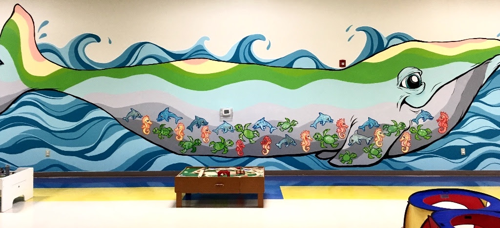 The final Pearl Buck Center mural by Bayne Gardner and students.
