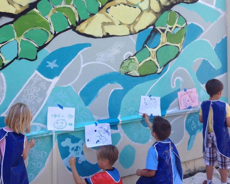 Kids paint their part of the Turtle Mural at Emerald Park, design by Muralist Bayne Gardner.