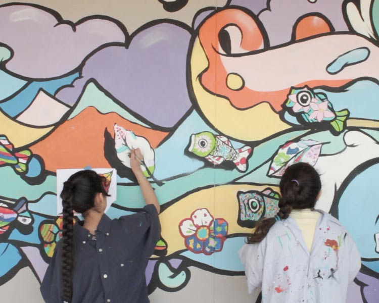 Students gets to add a personal touch to their schools Imagination Mural Project.