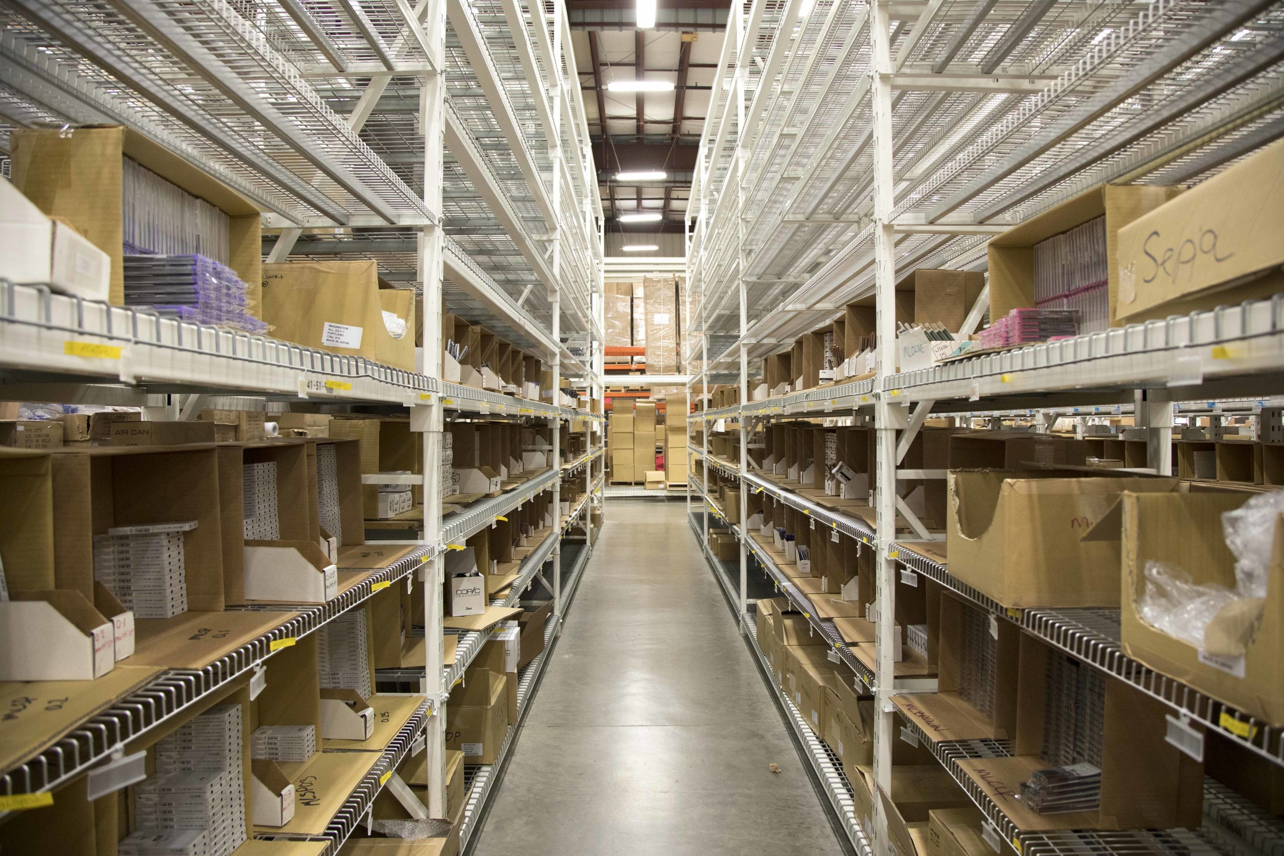 Shelves at Imagination International new warehouse