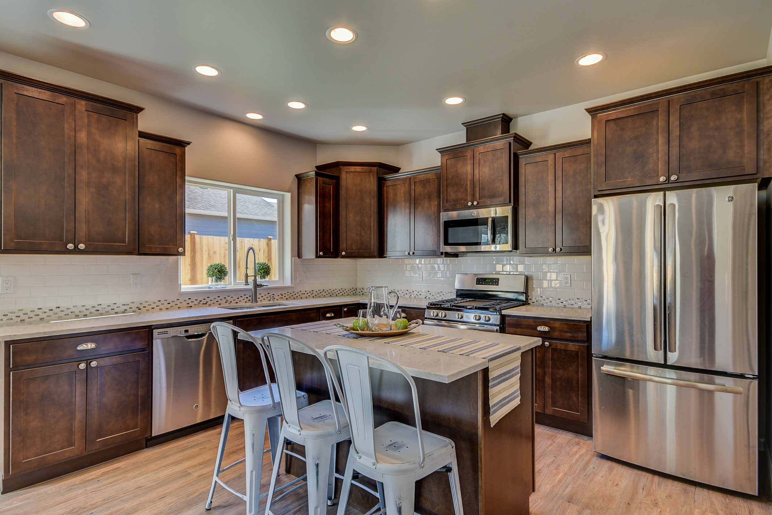 What's cookin'? A fabulous kitchen!... Quartz counter-tops, dining-island, ample storage space, & all appliances stay...