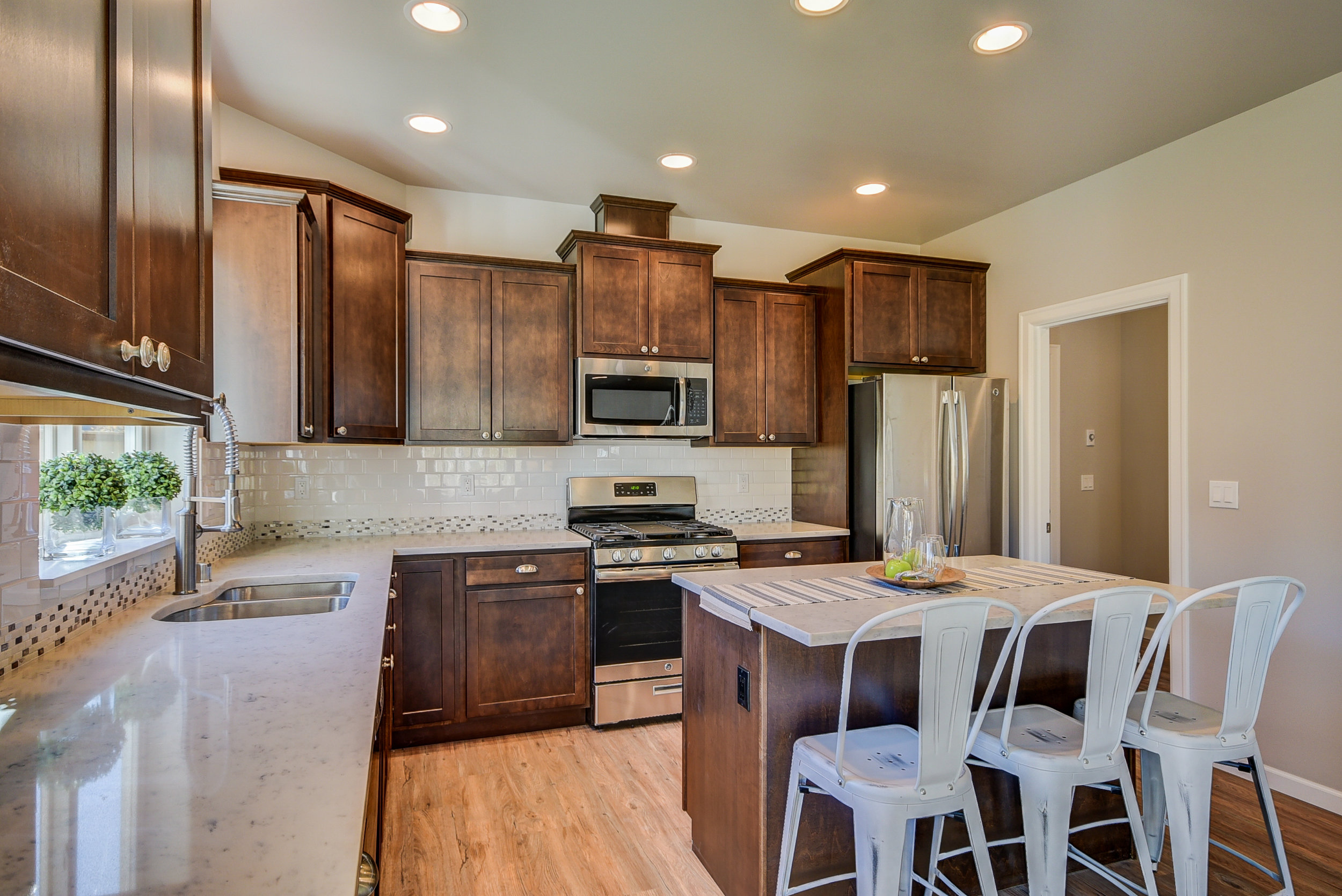 "Yes...this gorgeous kitchen raises the bar for a ""standard model"" kitchen...Make it your own w/color choice of cabinets & counters. It will be an oasis for sophisticated foodies........."