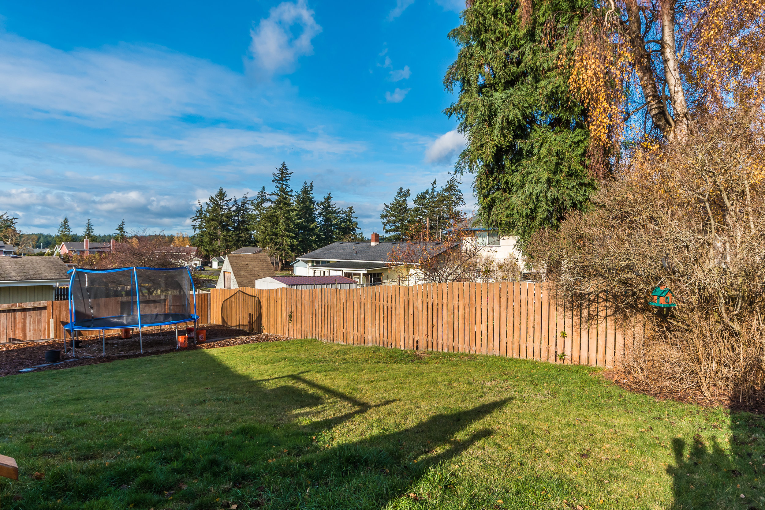 A fantastic, fully fenced back yard...complete with sprinkler system!
