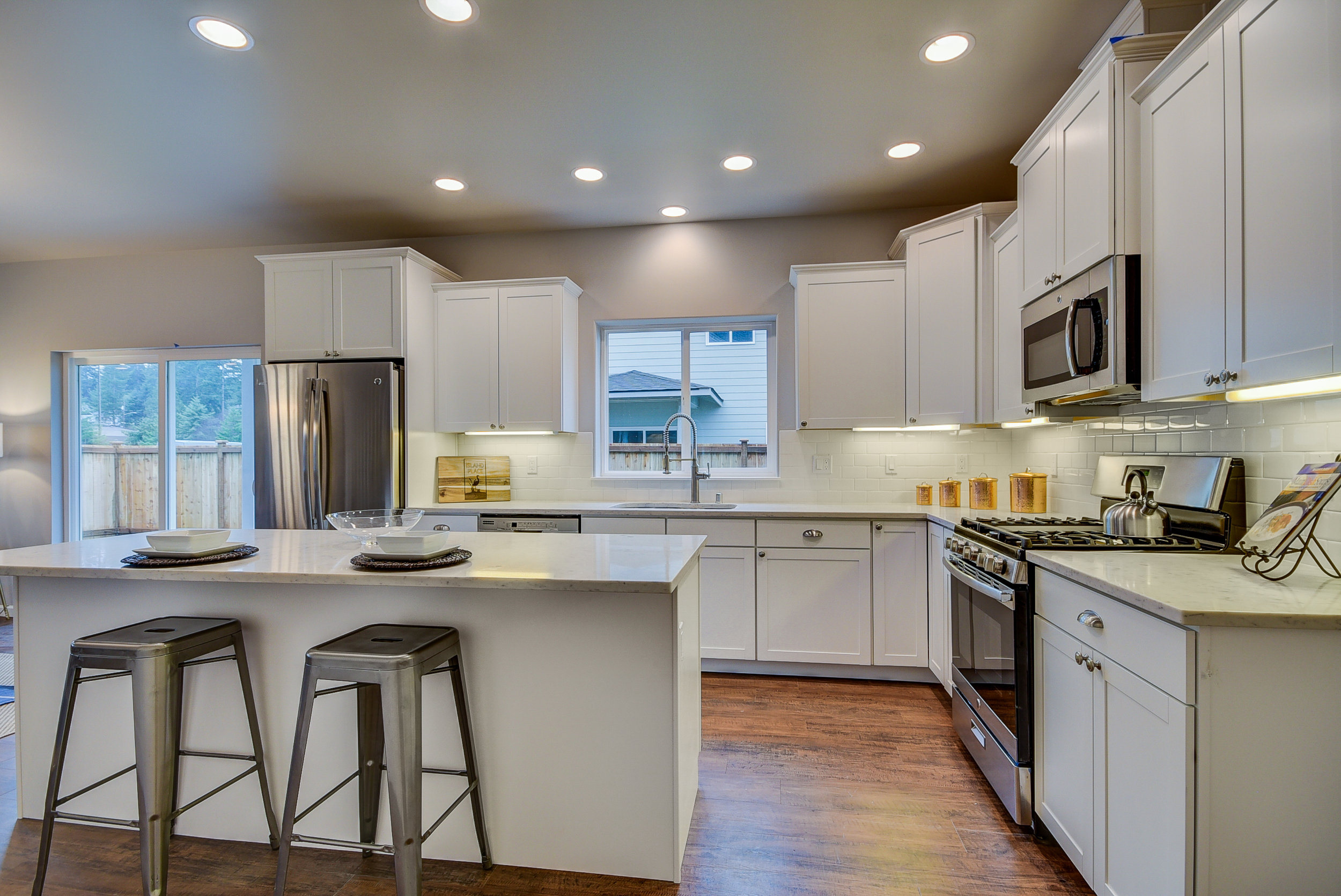 """Yes...this gorgeous kitchen raises the bar for a """"standard model"""" kitchen... It will be an oasis for sophisticated foodies........."""
