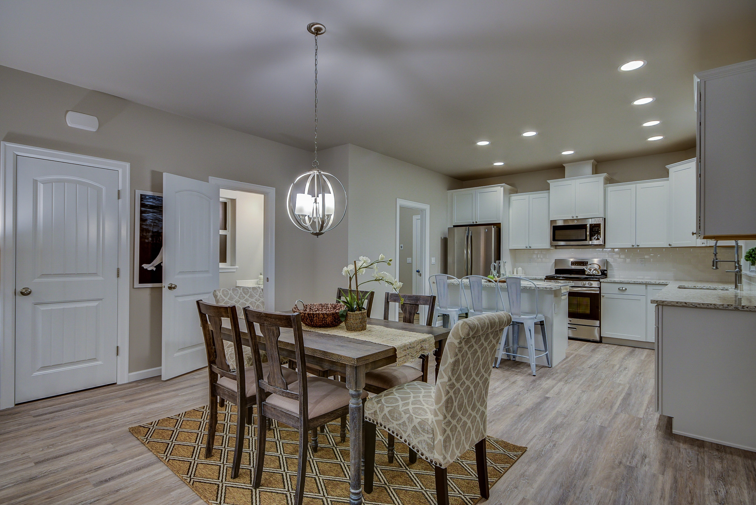 Entertain with confidence in this dining space! Spacious & versatile...ready for casual coffee talk, or a sparkling fête...