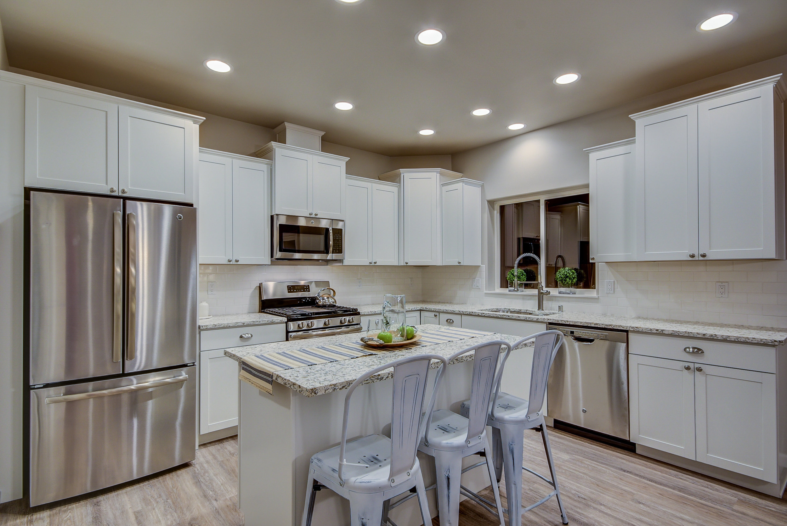 """Yes...this gorgeous kitchen raises the bar for a """"standard model"""" kitchen..It will be an oasis for sophisticated foodies............"""