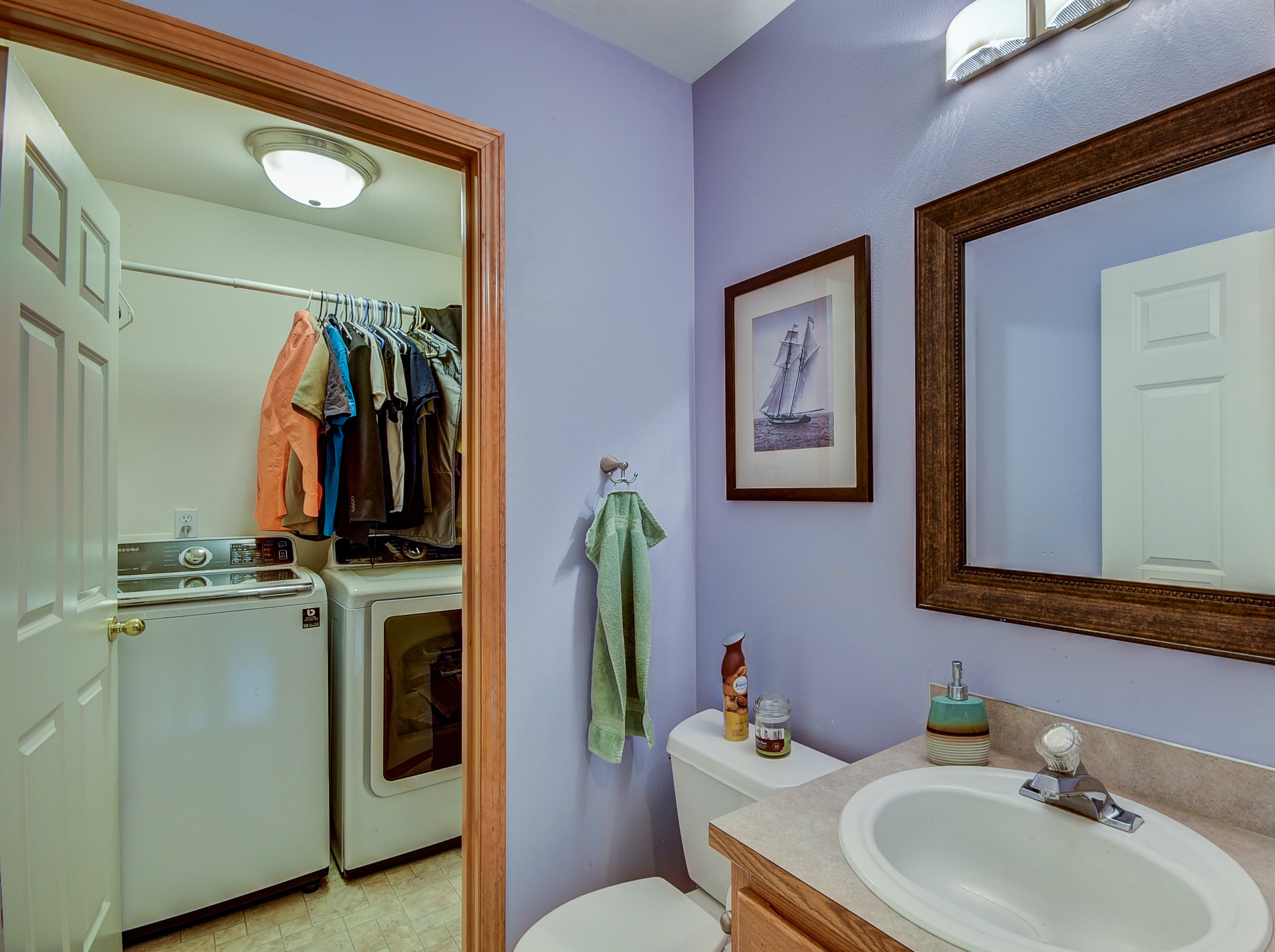 Conveniently set downstairs is the utility room & a half bath...