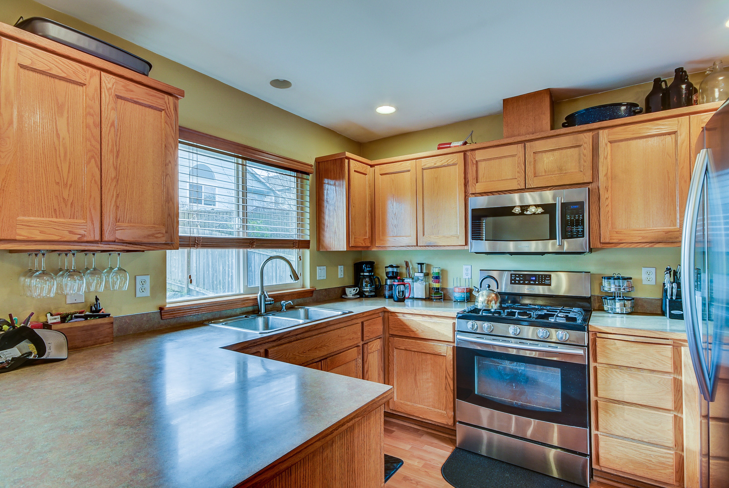 With abundant counter-top & cabinet space, newer stainless steel appliances, recessed lighting, & a breakfast bar....this kitchen has it all!