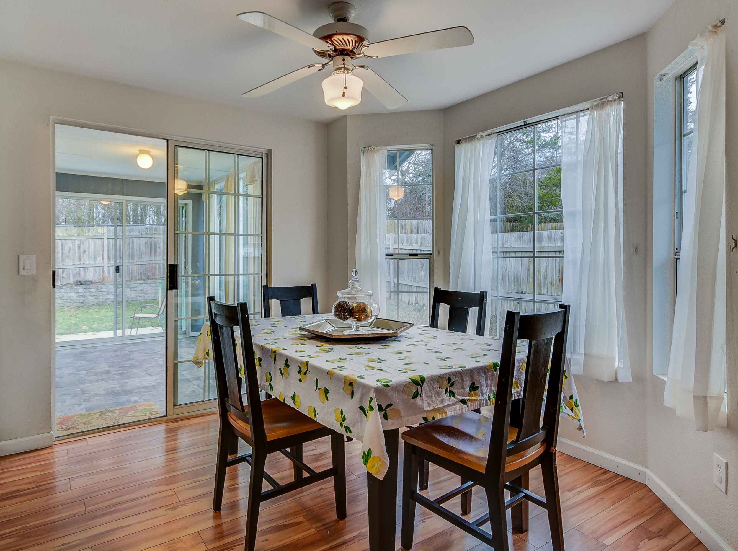 What a sweet breakfast nook--even on a dreary day, look at all of that natural light! Through the sliders, you can see the sun room...