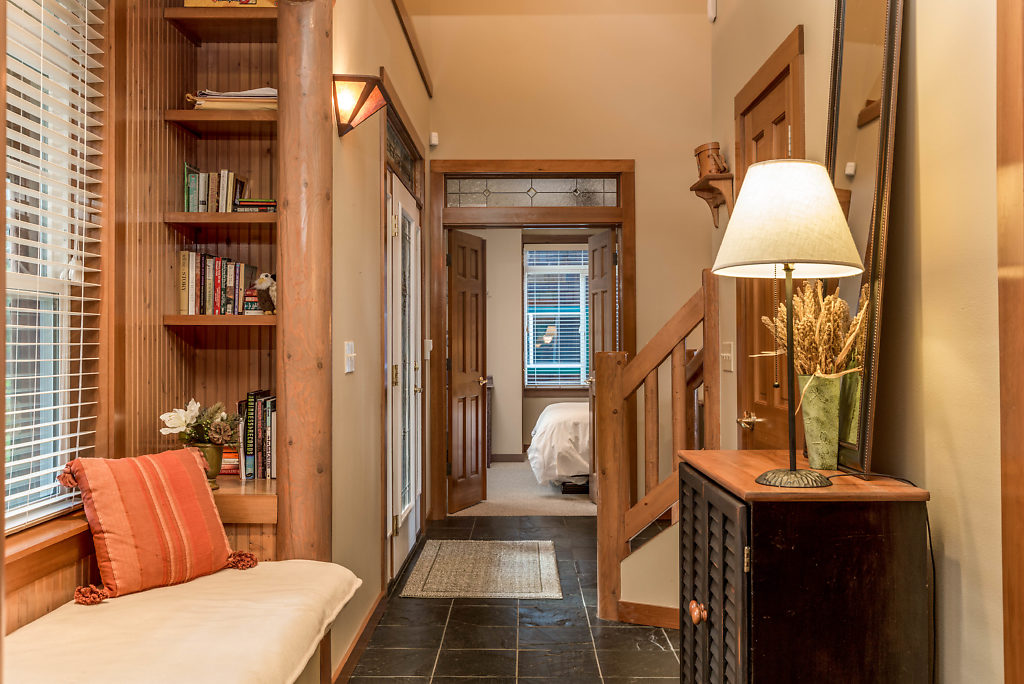 Down the hallway is a main level bedroom...and on the left is a cozy reading nook with built in shelving...