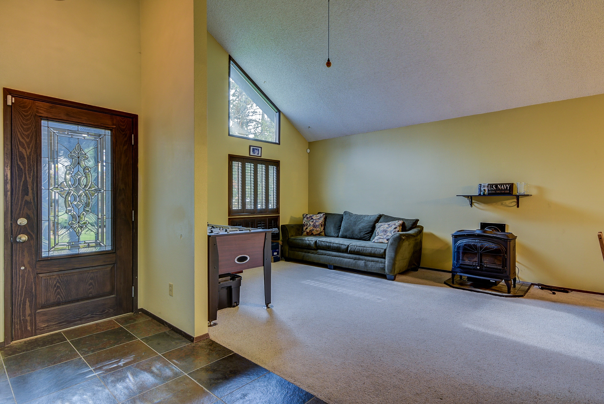 Slate entry...spacious living room with gas fireplace...and vaulted ceilings....this house has been a solid rental for years & has the potential to be an AMAZING home!!
