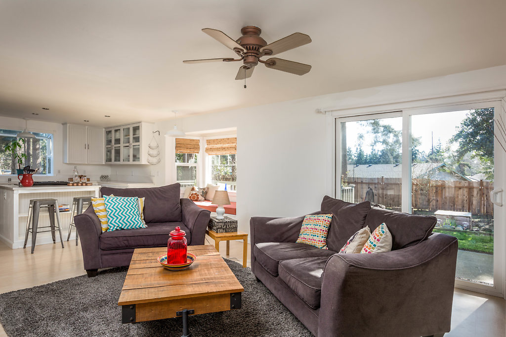The family room has durable laminate flooring, fast access to your fully fenced back yard (new cedar fence in 2017), and a seamless transition to the eat-in kitchen...complete with quartz counters, & ample storage!...