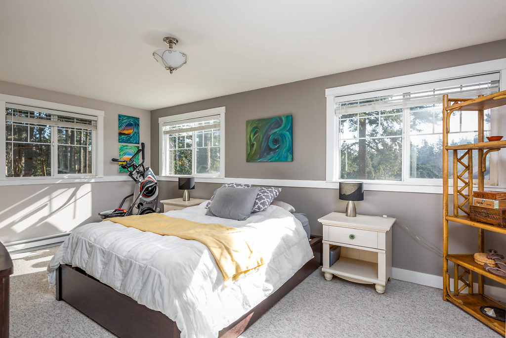 A spacious master suite...look at all of the amazing windows!