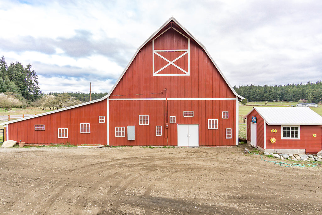 Yes! This timeless red barn is included! There is over 4300 sf of renovated potential in this space...what are YOUR dream plans for this space? They can become a reality...the hard work has been done!...