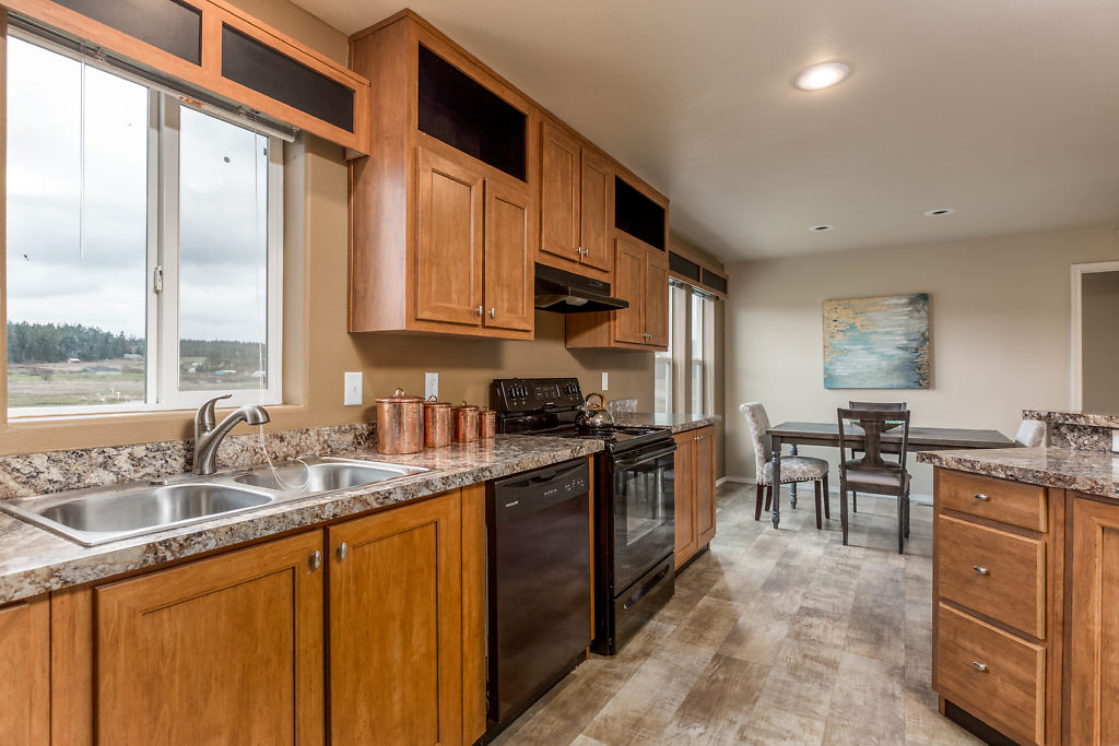 Quality appliances...warm toned cabinetry...and bucolic views through the windows...fabulous.