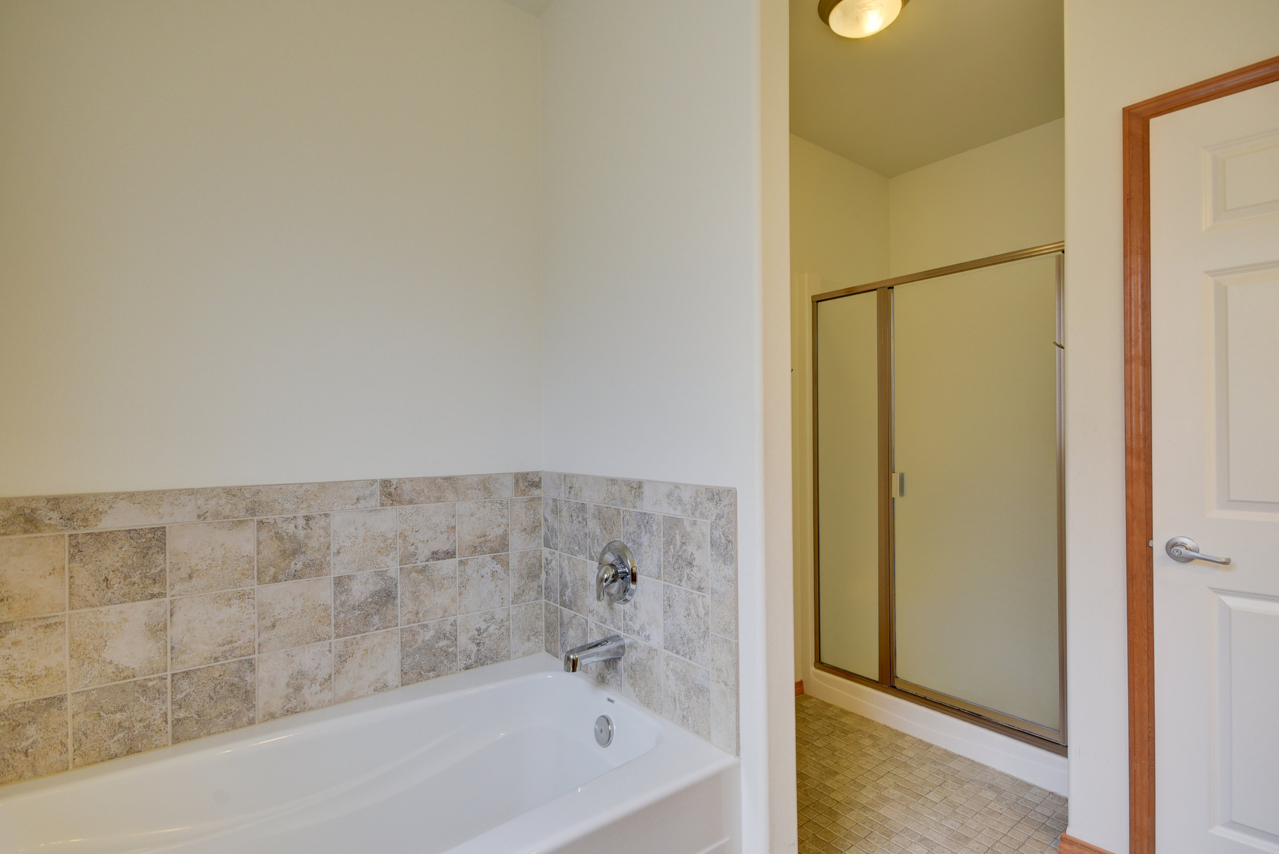 Master suite with soaking tub, shower, & linen closet...wow!