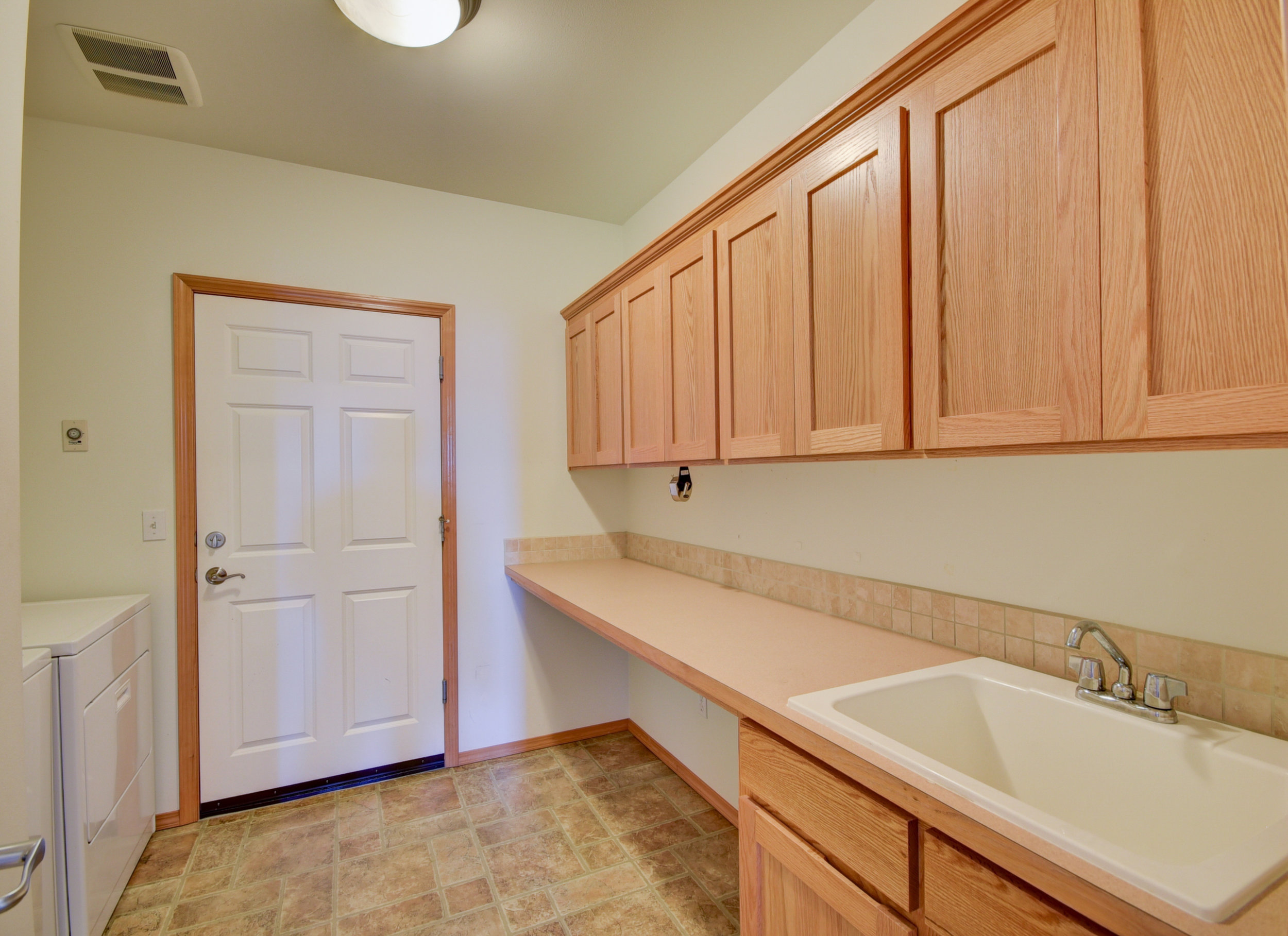 Utility room with deep sink & even MORE storage!