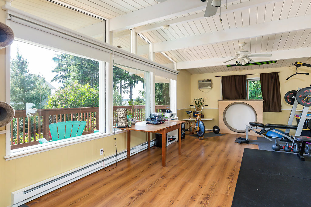 ...The 2nd living room is spacious, inviting, & bright. There are TWO sets of dual paned windows--amazingly efficient for keeping the temperature just the way you like it--as well as extra protection from any external noise.......