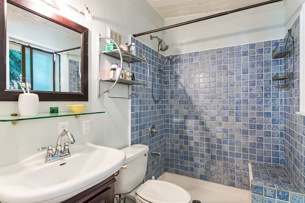 The master bath with custom tiled shower...