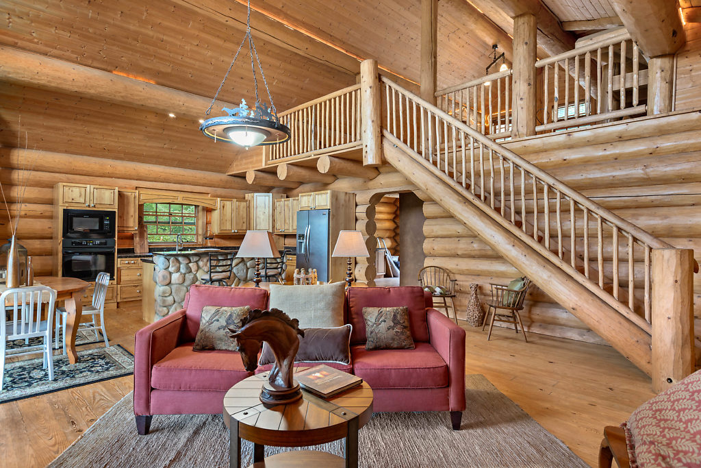 Hardwood floors, soaring ceilings, and authentic river-rock accents help to make this country cabin feel rustic & inviting. Enjoy the coziness without sacrificing luxury details you were hoping for.