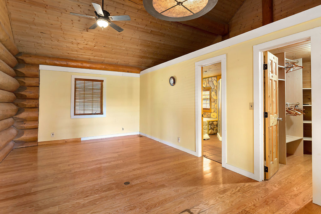 Main level Master Suite with 5-piece bath and walk-in closet...There's even a storage loft above! Thoughtful & convenient!