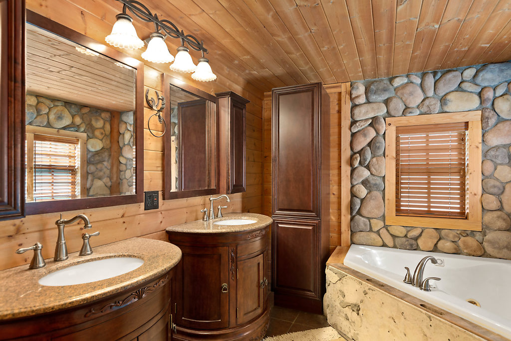 Master bath with clear cedar ceiling, dual vanities, jetted tub, and ceramic tile floor...Fabulous!