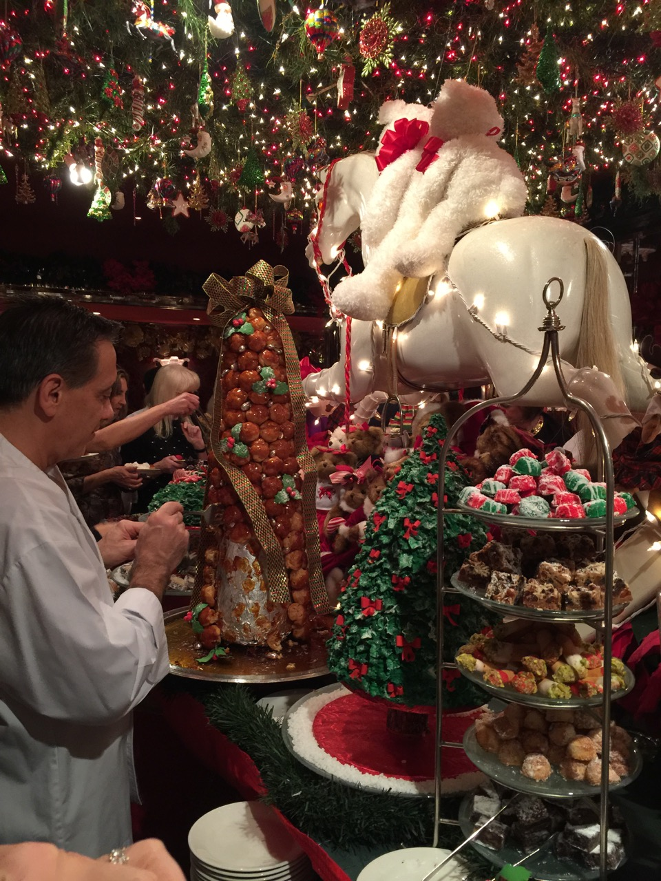 Chef Stephen Mallina adjusting the croquembouch at the Christmas dessert buffet