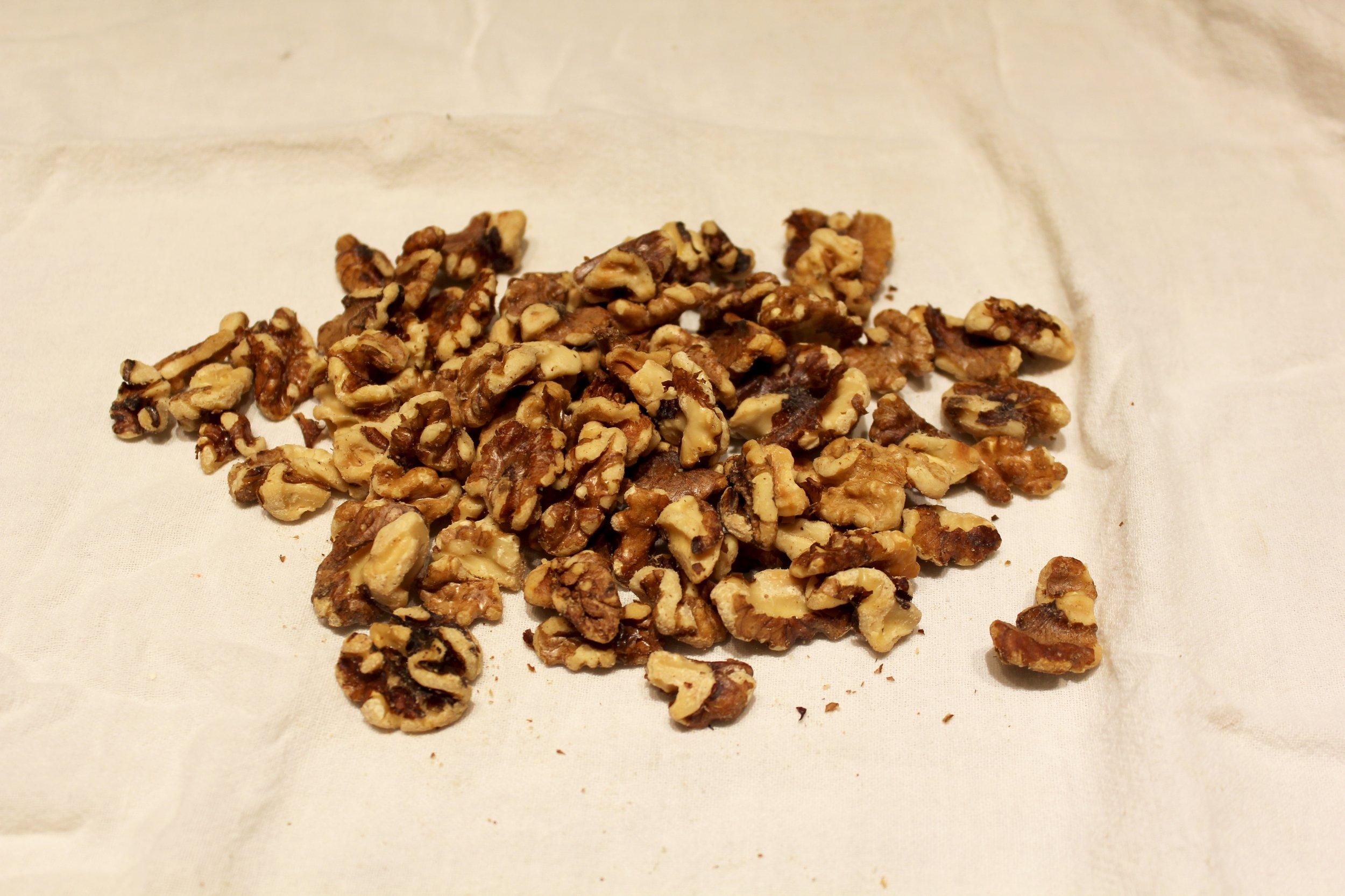 1b. turn nuts onto a dish towel