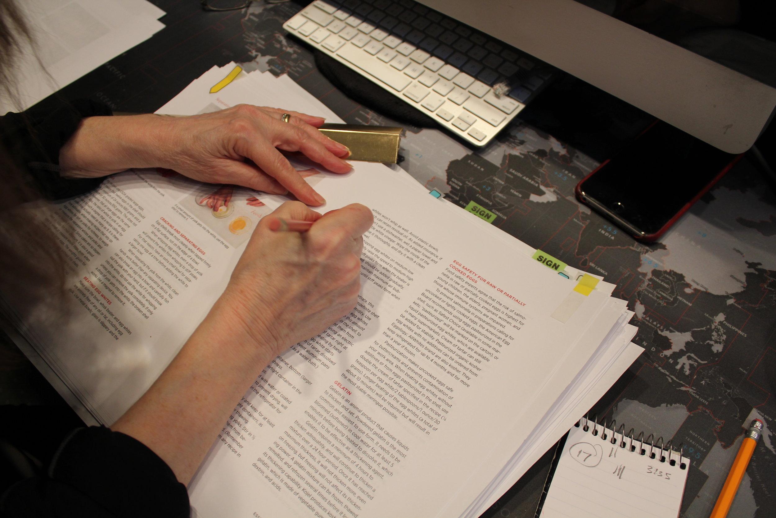 Rose correcting manuscript.JPG