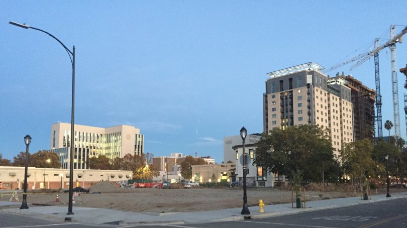 George Avalos / Bay Area News Group  An empty lot in the North San Pedro area of downtown San Jose, with a portion of the city skyline visible nearby. A plan to build several dozen residential units in downtown San Jose might be the vanguard of wide-ranging efforts to transform some blighted blocks, decaying buildings and vacant lots in the city's urban heart into a vibrant new neighborhood.