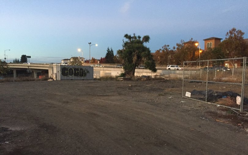 George Avalos / Bay Area News Group  Evening commuters drive past vacant lots in downtown San Jose's North San Pedro district.