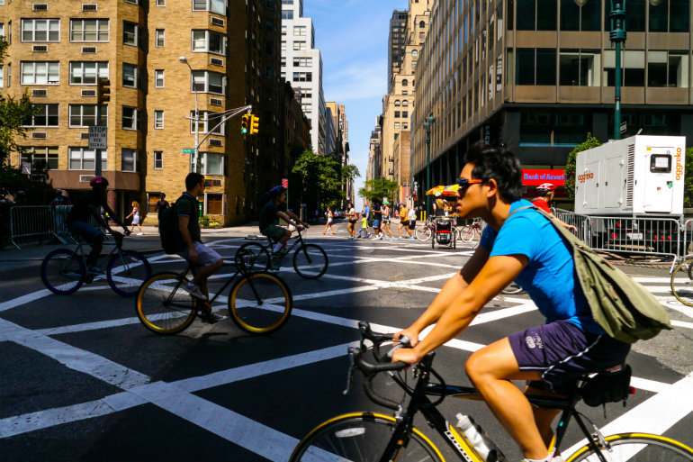 Bicyclist, joggers and walkers enjoy car-free streets as part of New York City's Summer Streets program.(Shutterstock)
