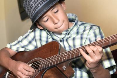 Guitar student performs during Bravo's Student Recital