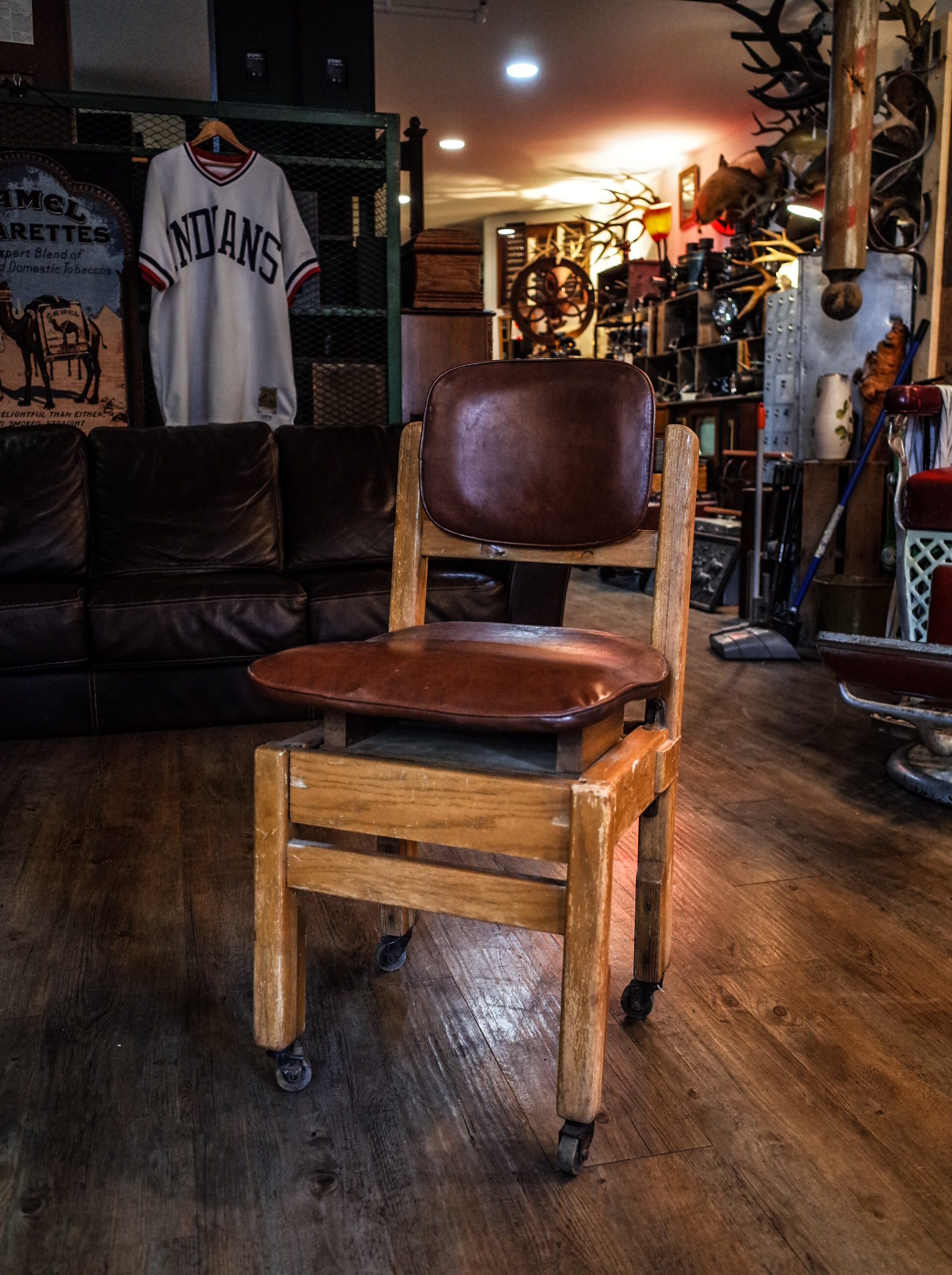 wooden-leather-chair-on-wheels.jpg